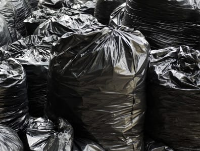 Black refuse sacks ready for removal